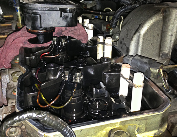 "Valve train on Cummins Diesel. The wooden ""pushrods"" are a tool to hold up the tappets while the camshaft is removed. Another thoughtful repair procedure courtesy of Cummins."